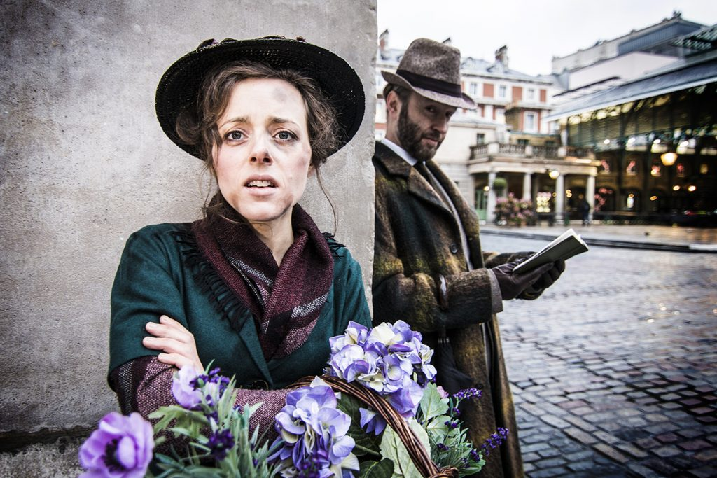 Mimi Kroll and Stephen Russell as Eliza Doolittle and Professor Henry Higgins in the plaza in Covent Garden for the My Fair Lady promotional photoshoot